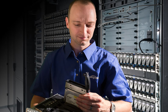 Man in blue shirt in a server room
